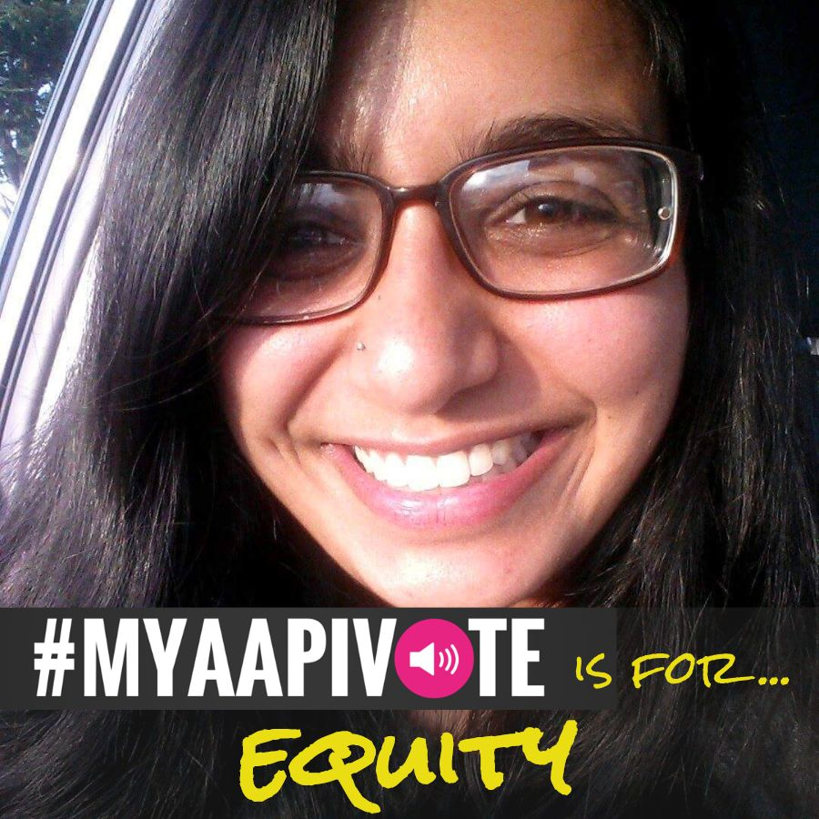 South Asian woman with glasses smiling. MYAAPIVOTE is for equity is at the bottom of the image.